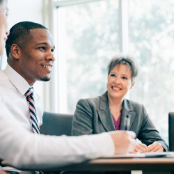 Multiracial Business Team meeting in board room